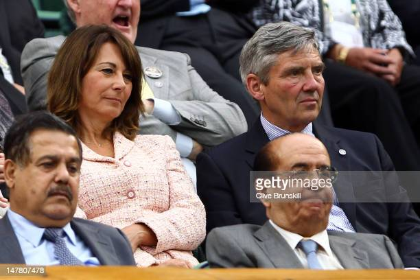 Carole Middleton and Michael Middleton sit in the Royal Box in Centre Court on day eight of the Wimbledon Lawn Tennis Championships at the All...
