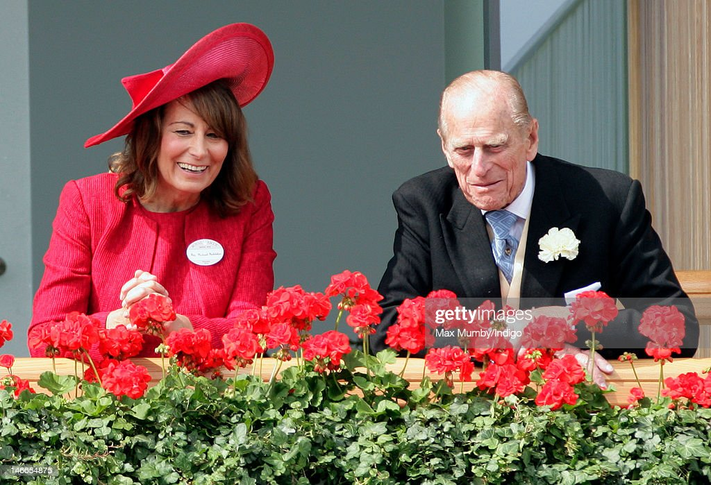 Carole Middleton and Prince Philip, Duke of Edinburgh watch the horses in the parade ring as they attend Ladies Day during Royal Ascot at Ascot Racecourse on June 21, 2012 in Ascot, England.