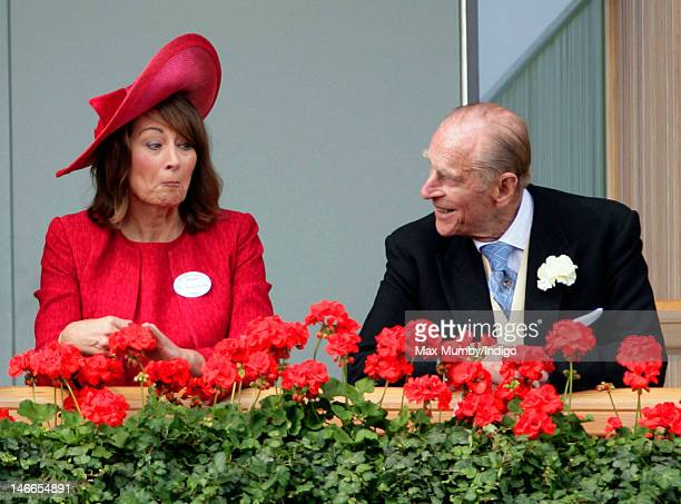 Carole Middleton and Prince Philip Duke of Edinburgh watch the horses in the parade ring as they attend Ladies Day during Royal Ascot at Ascot...