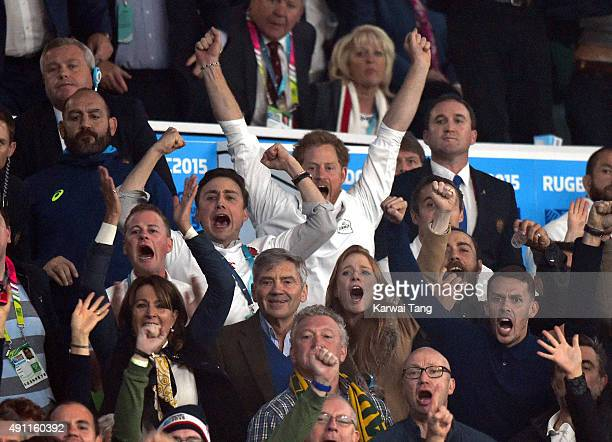Carole Middleton, Michael Middleton, Prince Harry and James Middleton attend the England v Australia match during the Rugby World Cup 2015 on October...