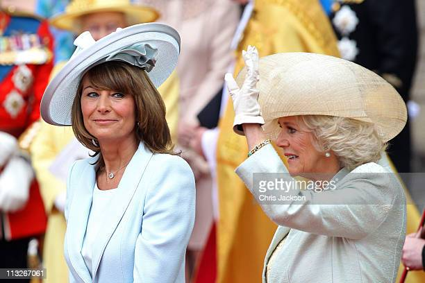 Carole Middleton smiles as Camilla Duchess of Cornwall waves to the cheering crowds following the marriage of Prince William Duke of Cambridge and...