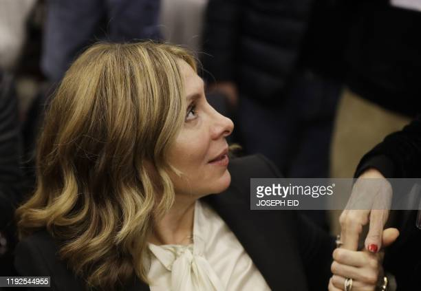 Carole the wife of former RenaultNissan boss Carlos Ghosn attends a press conference in which her husband addressed a large crowd of journalists on...