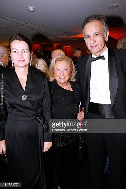 Carole Weisweiller standing between CEO of Sotheby's France Guillaume Cerutti and his wife Marjorie Cerutti attend AROP Gala at Opera Bastille with a...