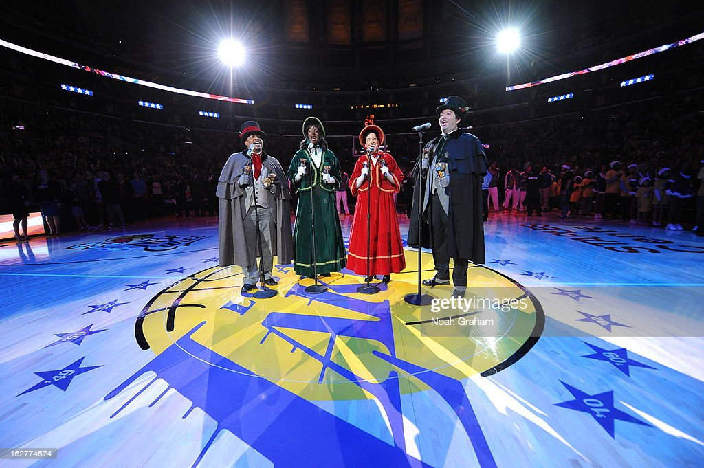 Carolers perform on the court before the game where the New York Knicks played against the Los Angeles Lakers at Staples Center on December 25, 2012 in Los Angeles, California.