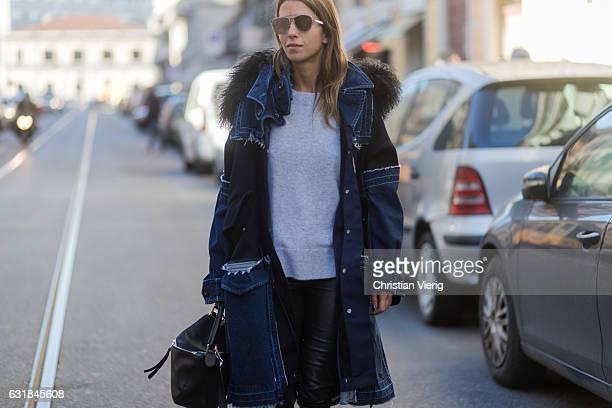 Carolia Bernard wearing a denim parka Loewe bag at No 21 during Milan Men's Fashion Week Fall/Winter 2017/18 on January 16 2017 in Milan Italy