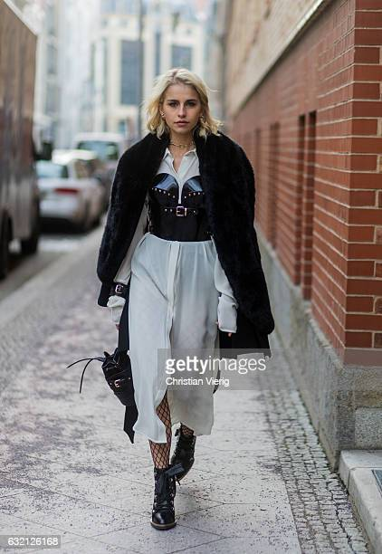 Carolie Caro Daur wearing white sheer dress fur coat at Marina Hoermanseder during the MercedesBenz Fashion Week Berlin A/W 2017 at Kaufhaus Jandorf...