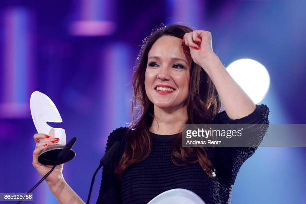 Carolin Kebekus poses with her award for best comedian on stage at the 21st Annual German Comedy Awards at Studio in Koeln Muehlheim on October 24...