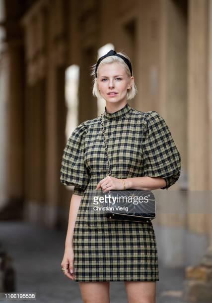 Carolin Laufenburger wearing plaid dress Ganni Chanel bag seen on August 04 2019 in Berlin Germany
