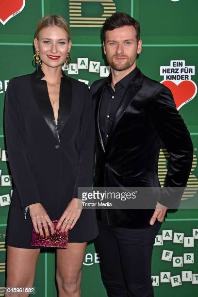 Carolin Niemczyk Daniel Grunenberg of the duo Glasperlenspiel attend the charity event PLACE TO B Playing for Charity at Restaurant GRACE on October...