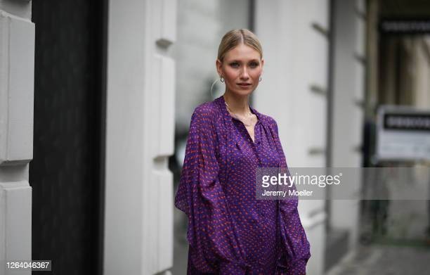 Carolin Niemczyk wearing Lala Berlin dress, Prada bag and New Balance sneaker on August 03, 2020 in Berlin, Germany.