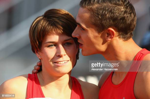 Carolin Nytra of Germany poses with her boyfriend Sebastian Bayer after wining the Women 100m hurdles Final on day one of the German National...
