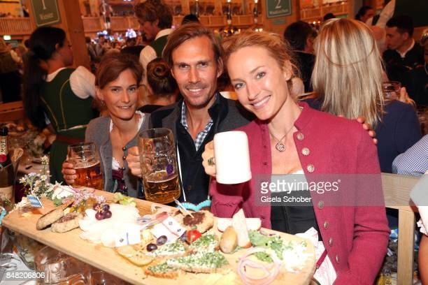 Carolin Pohl, Tino Schuster and Petra Winter during the 'Fruehstueck bei Tiffany' at Schuetzenfesthalle at the Oktoberfest on September 16, 2017 in...