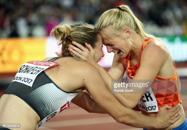 Carolin Schafer of Germany and Anouk Vetter of the Netherlands celebrate after the Women's Heptathlon 800 metres and winning silver and bronze in the...
