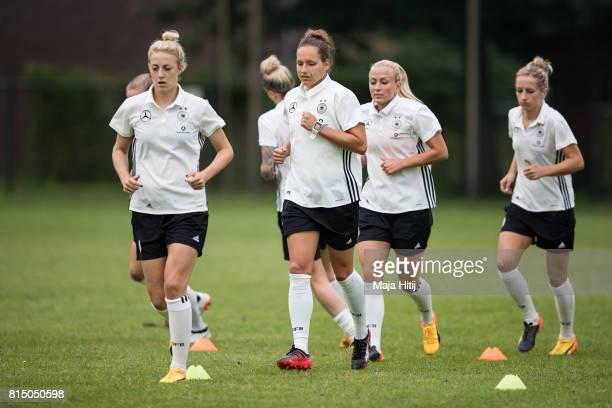 'SHERTOGENBOSCH NETHERLANDS JULY 15 Carolin Simon Babett Peter Mandy Islacker and Kathrin Hendrich run during the training of a Germany Women's team...