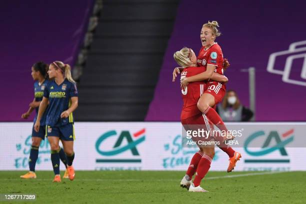 Carolin Simon of FC Bayern Munich celebrates with teammate Hanna Glas after scoring her team's first goal during the UEFA Women's Champions League...