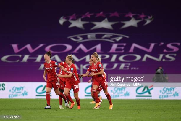 Carolin Simon of FC Bayern Munich celebrates with teammates after scoring her team's first goal during the UEFA Women's Champions League Quarter...