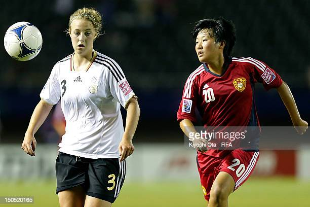 Carolin Simon of Germany and Shen Lili of China compete for the ball during the FIFA U20 Women's World Cup Japan 2012 Group D match between Germany...
