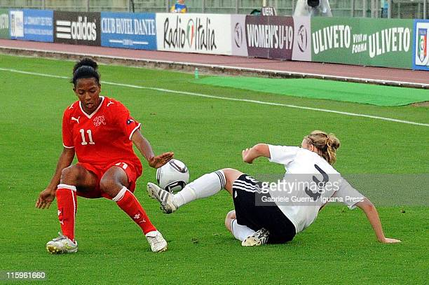 Carolin Simon of Germany competes with Eseosa Aigbogun of Switzerland during semifinal game between Germany and Switzerland of Women's Under 19...
