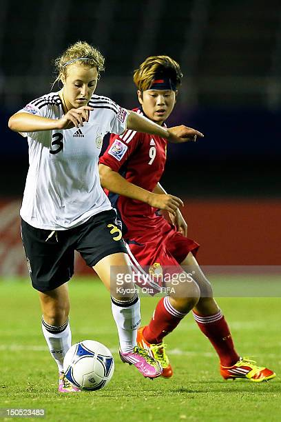 Carolin Simon of Germany controls the ball against Li Ying of China during the FIFA U20 Women's World Cup Japan 2012 Group D match between Germany...