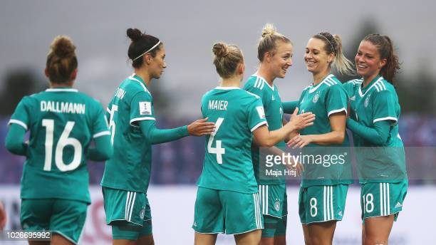 Carolin Simon of Germany is congratulated by Lena Goessling of Germany after scoring a goal during the Faeroe Islands Women's v Germany Women's 2019...