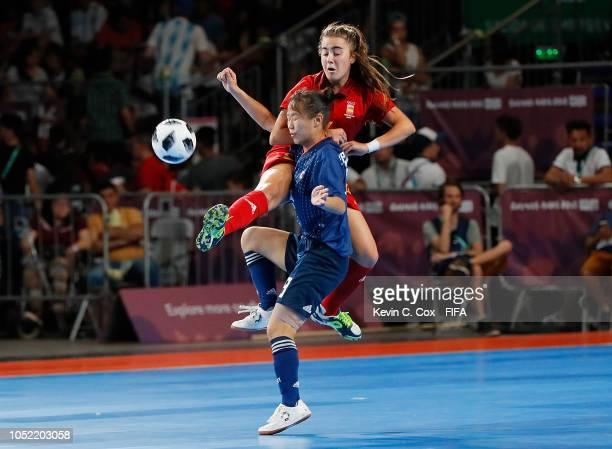 Carolina Agulla of Spain challenges Rikako Yamakawa of Japan in the Women's Futsal semifinal match between Spain and Japan during the Buenos Aires...