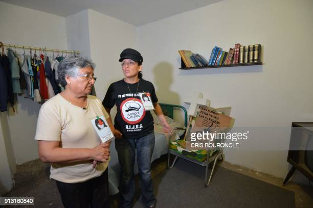 Carolina and her mother Carmen show her cousin Dora Oyagues bedroom and her belongings left untouched to honor her memory since she disappeared in...
