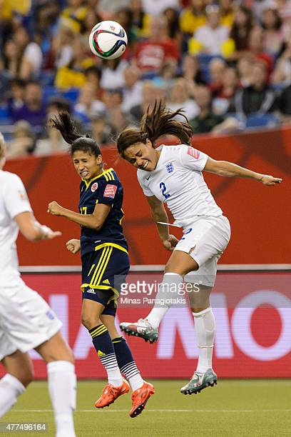 Carolina Arias of Colombia and Alex Scott of England jump for the ball during the 2015 FIFA Women's World Cup Group F match at Olympic Stadium on...