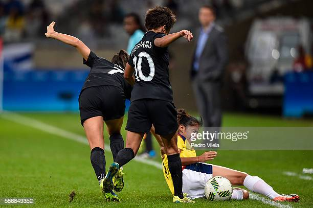 Carolina Arias of Colombia and Ali Riley and Sarah Gregorius of New Zealand battle for the ball during a match between Colombia and New Zealand as...