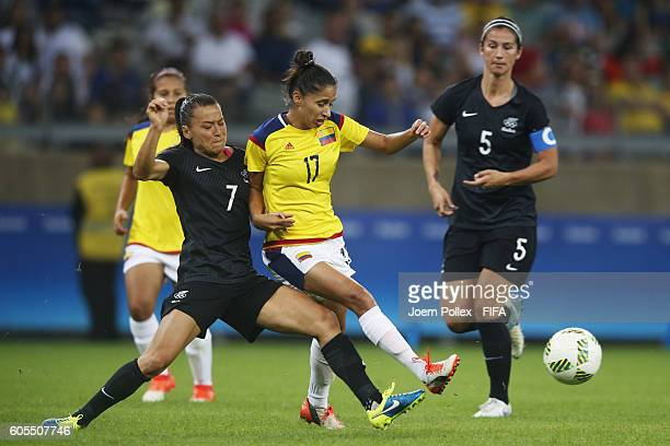 Carolina Arias of Colombia and Ali Riley of New Zealand compete for the ball during Women's Group G match between Colombia and New Zealand on Day 1...