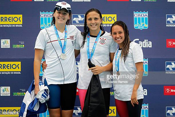 Carolina Bilich Gabriela Rocha and Amanda Caroline Delgado stands on the podium for girls 200m butterfly Junior 2 during Julio Delamare Trophy at...
