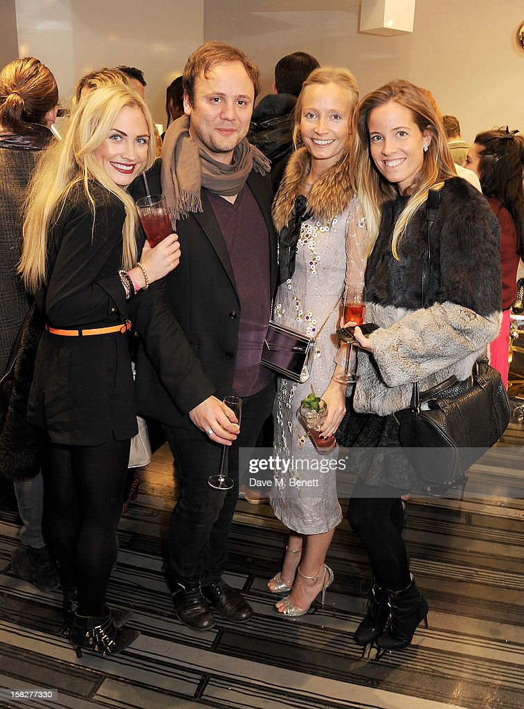 Carolina Bunster, Nicholas Kirkwood, Martha Ward and Ashley Warwa attend a Christmas drinks hosted by designer Nicholas Kirkwood to celebrate his partnership with Chambord black raspberry liquer, and launch the limited edition shoe 'The Chambord' at the Nicholas Kirkwood Mount Street store on December 12, 2012 in London, England.