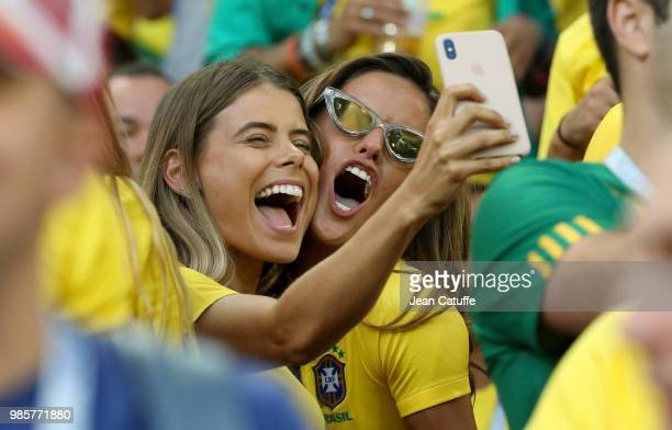 Carolina Cabrino wife of Marquinhos of Brazil and Izabel Goulart brazilian top model during the 2018 FIFA World Cup Russia group E match between...