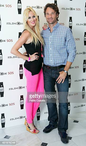 Carolina Cerezuela and Carlos Moya attend Omega Pharma Silincode SOS Charity Bracelet presentation on July 10, 2014 in Madrid, Spain.