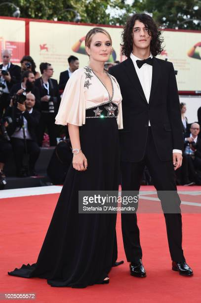 Carolina Crescentini and Francesco Motta walk the red carpet ahead of the opening ceremony and the 'First Man' screening during the 75th Venice Film...