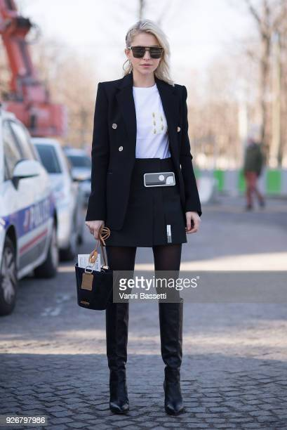 Carolina Daur poses wearing a Prada skirt and a Jacquemus bag after the Elie Saab show at the Grand Palais during Paris Fashion week Womenswear FW...
