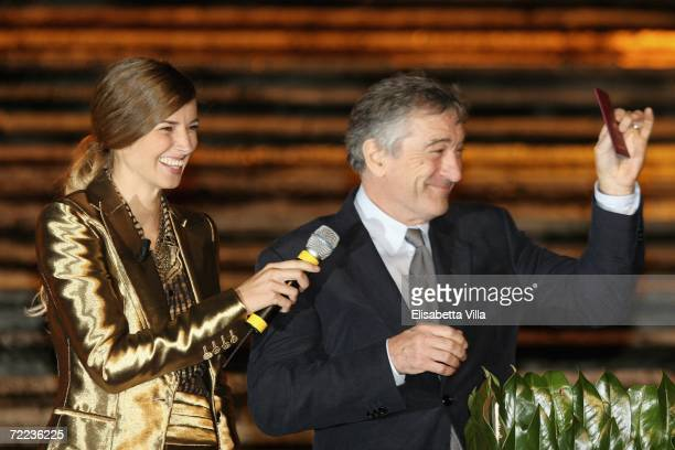 Carolina Di Domenico smiles as actor Robert De Niro gestures with his new Italian passport during the Steps And Stars Award in Piazza di Spagna as...