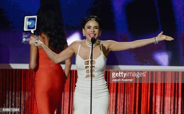 "Carolina Gaitan accepts award on stage at Telemundo's 2017 ""Premios Tu Mundo"" at American Airlines Arena on August 24, 2017 in Miami, Florida."