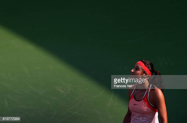 Carolina Garcia of France looks on in her match against Carla Suarez Navarro during day three of the WTA Dubai Duty Free Tennis Championship at the...