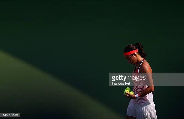 Carolina Garcia of France prepare to serve against Carla Suarez Navarro of Spain during day three of the WTA Dubai Duty Free Tennis Championship at...