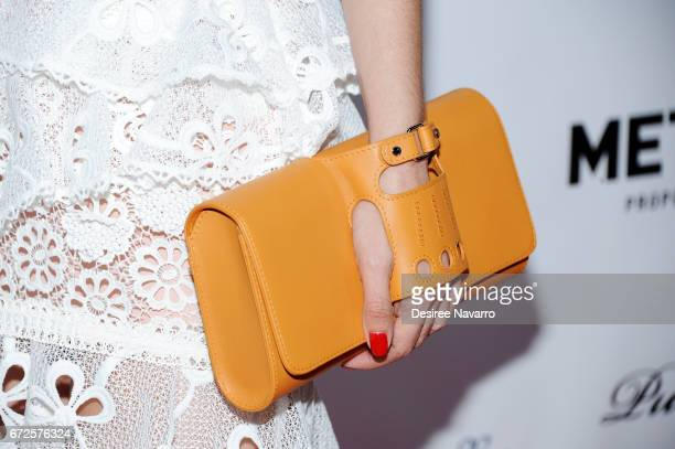 Carolina Gonzalez clutch detail attend BELLA New York Spring Issue Cover Party hosted by Kelly Osbourne at Bagatelle on April 24 2017 in New York City