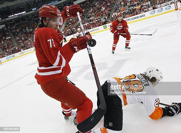 Carolina Hurricanes' Brett Bellemore bats a flying puck over Philadelphia Flyers' Claude Giroux during the first period at the PNC Arena in Raleigh...
