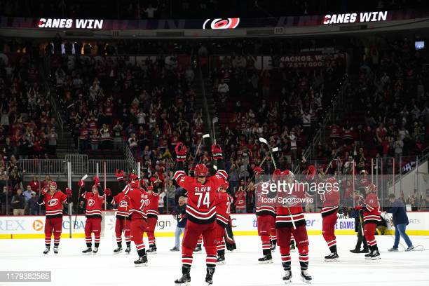 Carolina Hurricanes celebrate the storm surge during a game between the Calgary Flames and the Carolina Hurricanes at the PNC Arena in Raleigh NC on...