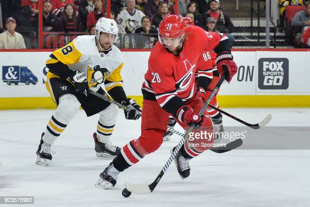 Carolina Hurricanes Center Elias Lindholm attempts to handle the puck during a game between the Pittsburgh Penguins and the Carolina Hurricanes at...
