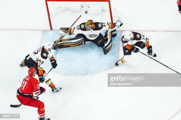Carolina Hurricanes Center Jordan Staal scores off a centering pass by Anaheim Ducks Defenceman Josh Manson and Anaheim Ducks Goalie Ryan Miller...