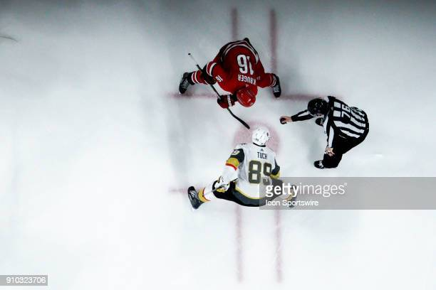 Carolina Hurricanes Center Marcus Kruger and Vegas Golden Knights Right Wing Alex Tuch await the puck to be dropped by NHL Linesman Michel Cormier...
