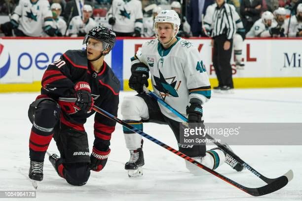 Carolina Hurricanes Center Sebastian Aho and San Jose Sharks Center Antti Suomela kneel aft4er colliding during a game between the Carolina...