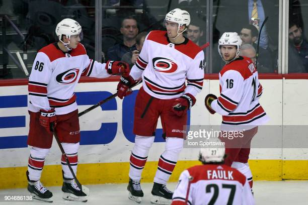 Carolina Hurricanes center Victor Rask is congratulated by left wing Teuvo Teravainen and center Marcus Kruger after his third period goal against...
