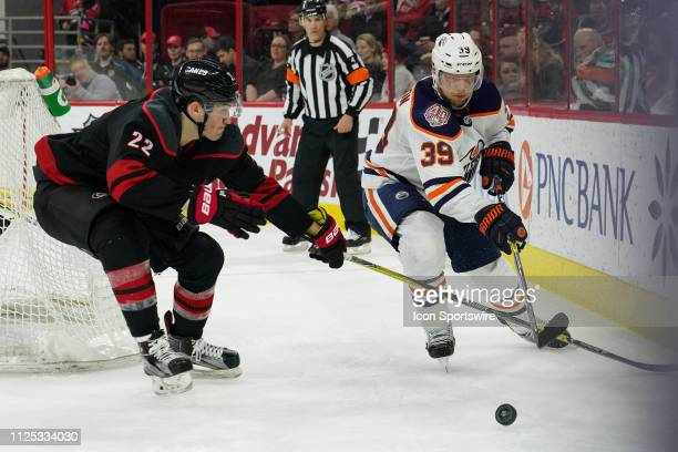 Carolina Hurricanes Defenceman Brett Pesce and Edmonton Oilers Right Wing Alex Chiasson battle for a puck along the boards during a game between the...