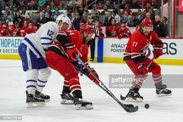Carolina Hurricanes Defenceman Calvin De Haan shields Toronto Maple Leafs Left Wing Patrick Marleau from the puck during a game between the Toronto...