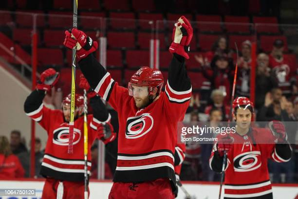 Carolina Hurricanes Defenceman Jaccob Slavin leads the team in a skol clap and Storm Surge after winning a game between the Carolina Hurricanes and...